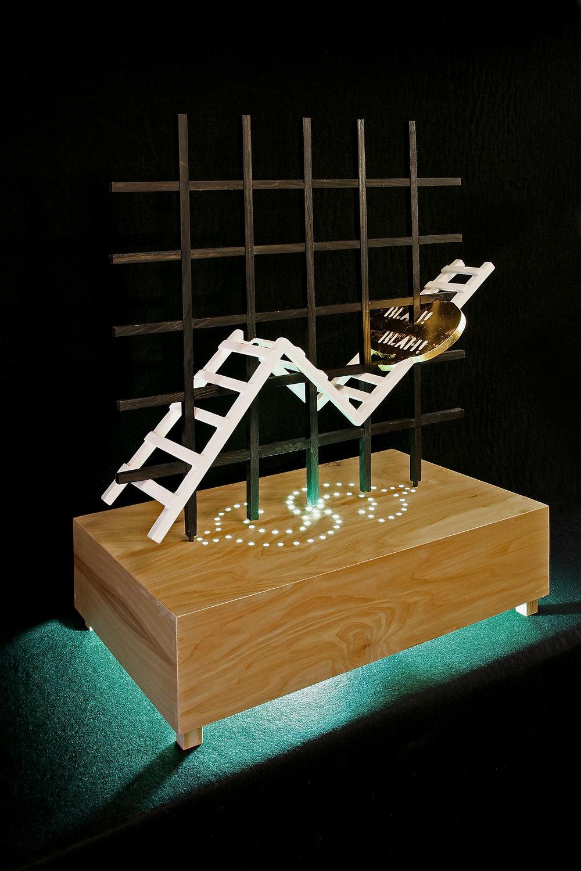 """Ladder Of Success"", 26"" h x 24"" w x 16"" d; wood, gold leaf, paint, plexi rod, LED lights, steel; © Tom Gormally 2017"