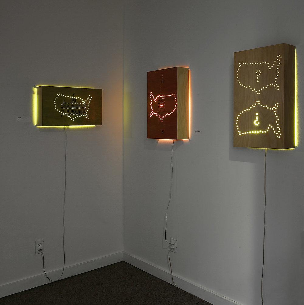 """Patriot Series"" installation, dimensions variable; wood, gold leaf, wood dye, plexi rod, LED lights; © Tom Gormally 2017"