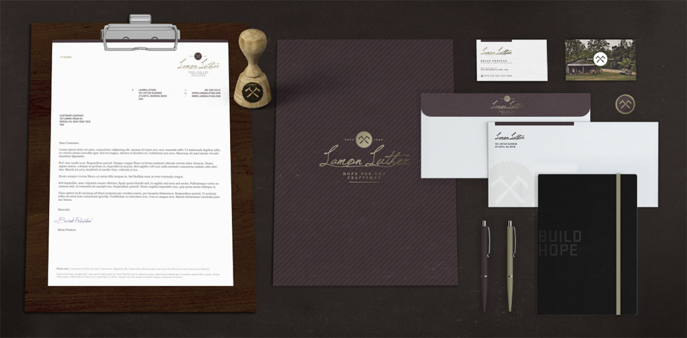 Suite of Lamon Luther branding collateral shows letterhead, folder, envelope, notebook, button, business cards as part of the brand's visual identity and graphic design of marketing materials.