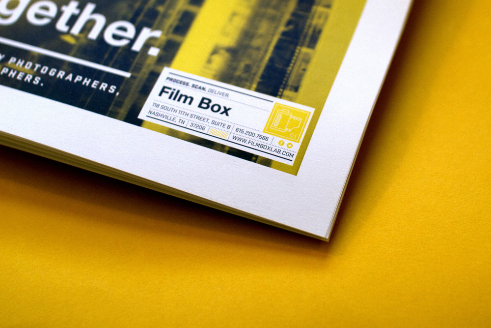 Cover design of Film Box newspapers shows a graphic text and icon lockup inspired by film canisters and old polaroid and kodak graphics.
