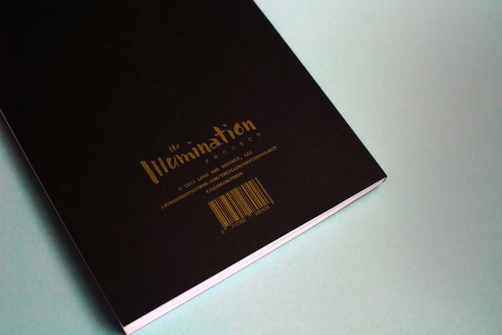 Back cover of the Illumination Project journal notebook shows the logo and barcode printed in gold ink on black paper.