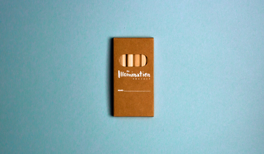 Custom white logo design on kraft paper box of miniature colored pencils.