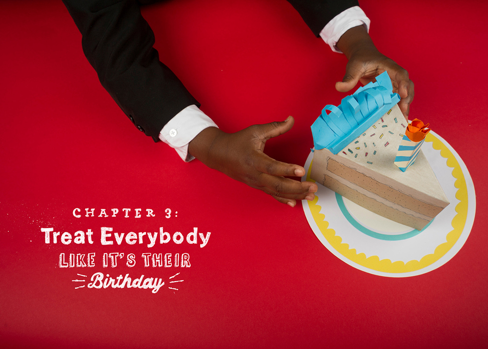 Chapter Three: Treat everybody like it's their birthday. Chapter divider header full spread photography, kid president reaches for a cupcake cake slice made out of paper and cardboard on a red background.