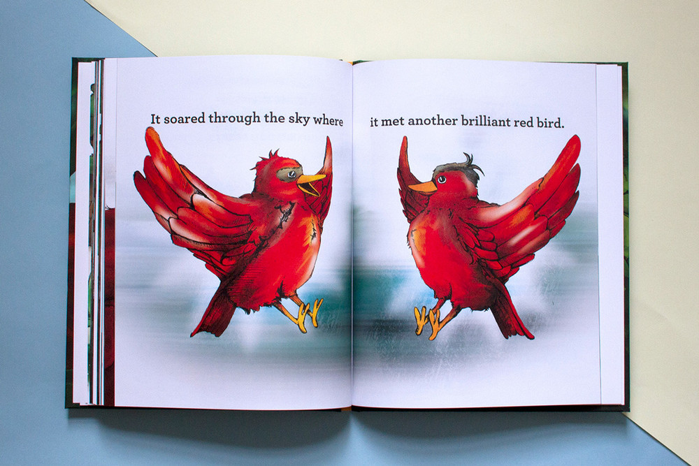 Two brilliant red birds meeting in the sky in an illustrated kid's book about adoption called Brilliant!