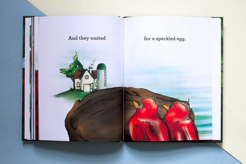 At the end of the children's book, the two brilliant red birds wait for a speckled egg of their own.