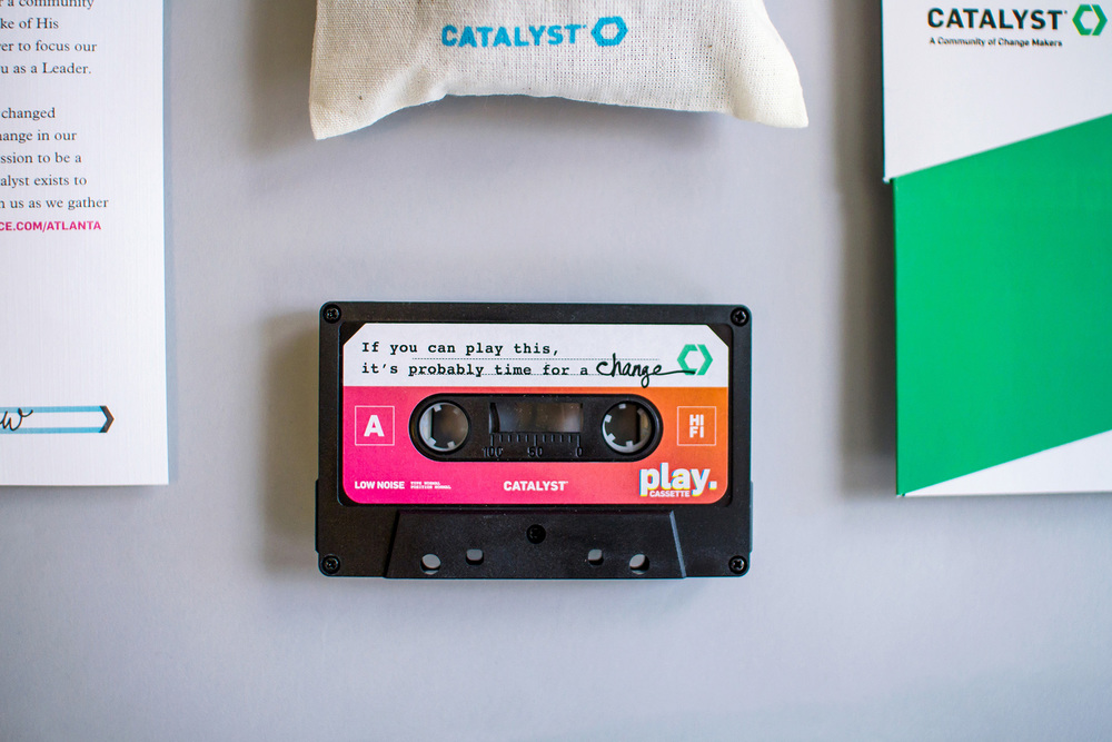 Catalyst Conference 2014 cassette tape with a custom designed label that reads If you can play this, it's probably time for a change.