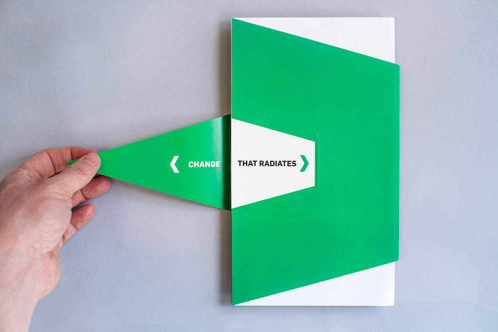 Catalyst Conference 2014 Atlanta Change That Radiates brochure design with a creative diecut and triangle-cut dieline that unfolds to reveal panels of promotional marketing design and conference theme event messaging and graphics.