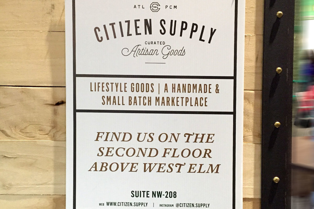 Citizen Supply logo design, curated artisan goods, sign inside Ponce City Market atlanta.