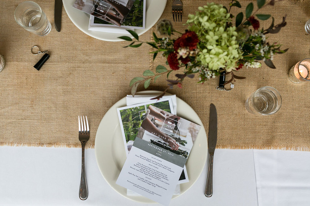 Table setting with menu and postcards designed for Serenbe as part of the Art Over Dinner visual brand identity and logo design project.