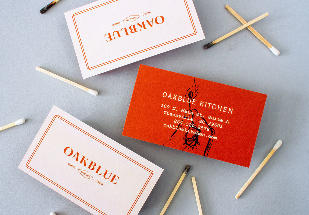 Front and back of Oakblue Kitchen restaurant business cards, branded collateral with custom logo design and illustrations.