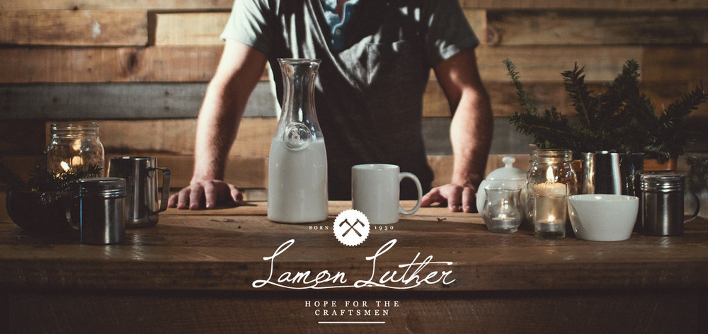 Lamon Luther Hope for the Craftsmen photo of man at rustic farm table made out of barn wood showing the logo design and visual brand identity for the company below.