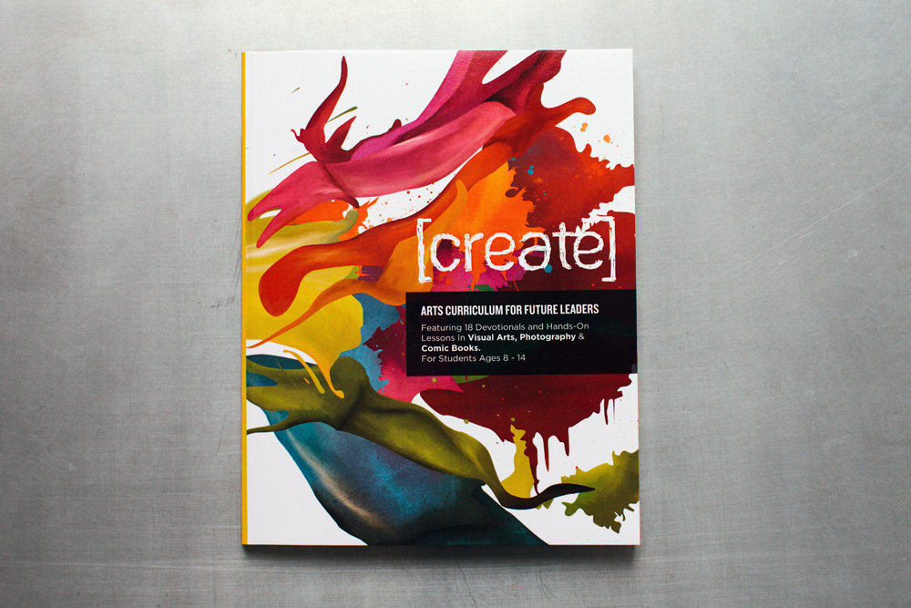 Create, an arts curriculum for kids, featuring 18 devotionals and hands-on lessons in visual arts, photography and comic books for students ages eight to fourteen. The cover design of the book features colorful painted paint blobs and shapes.