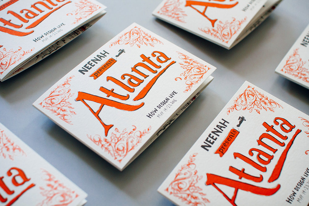 Neenah Paper presents Atlanta, How Design Live, May 19 2016. The illustrated cover shows hand lettering and titling for the series of maps and historical timelines. Floral filigree and decorations are borders in the corner. Two color red and black print on white paper.