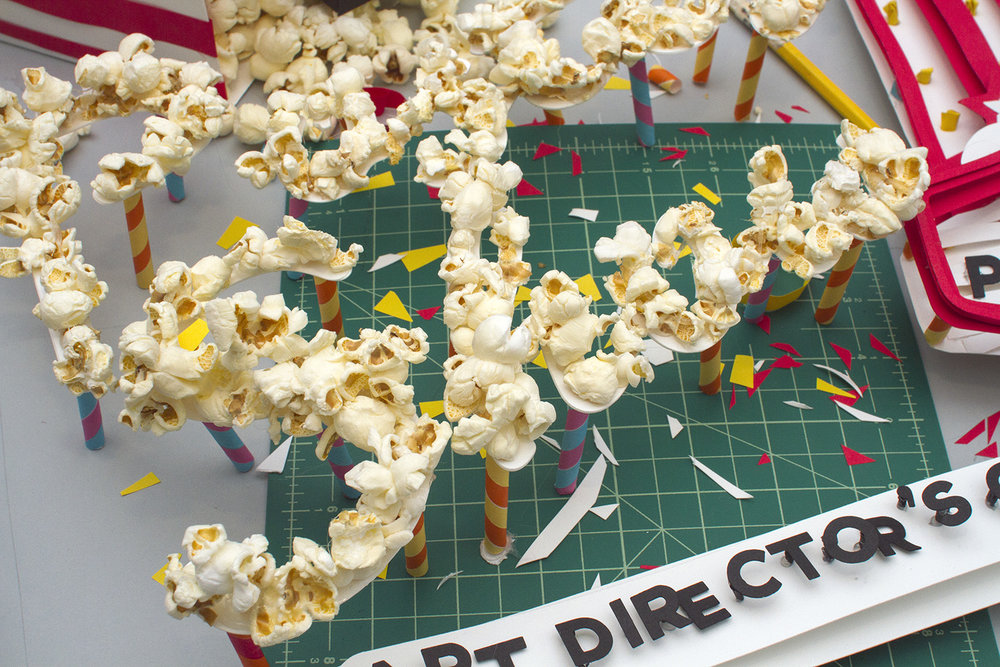 Behind the scenes detail of hand made paper craft art and popcorn typography for AIGA Atlanta Poster Show brand identity and promotional collateral.