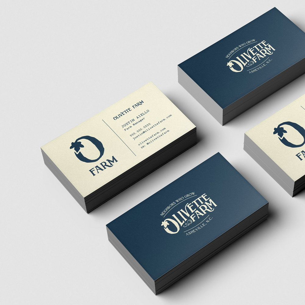 Stack of Olivette Farm business cards in navy and creamy tan shows the front and back of the design, as part of the branding and visual identity created for the farm.