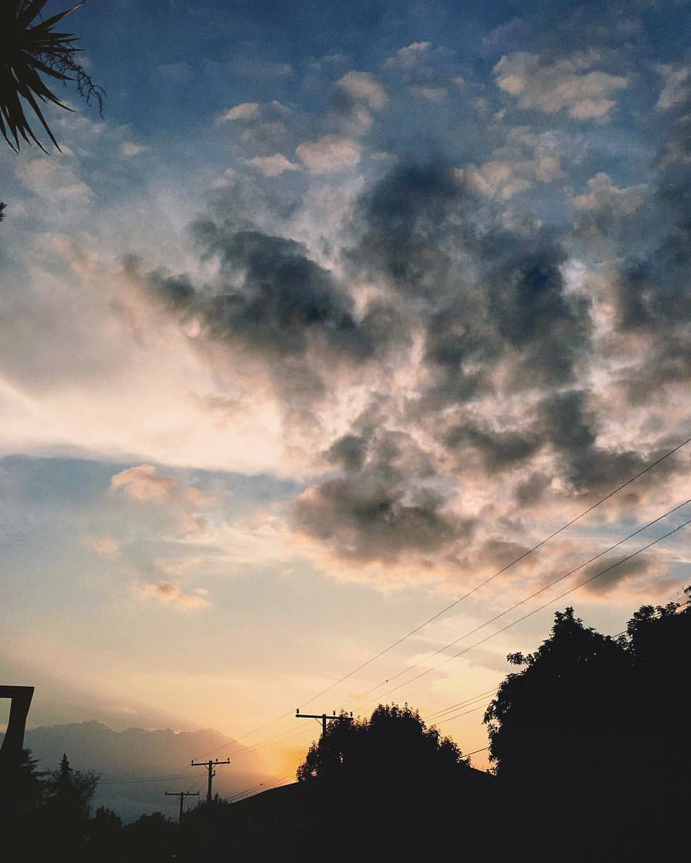 the-view-from-my-house-is-alright-sometimes-122366---sunset-clouds-cloudporn-deep-moody-fluff-silhouette-suburbia-lookslikefilm-sunrays-blue-and-cream_26838266304_o.jpg