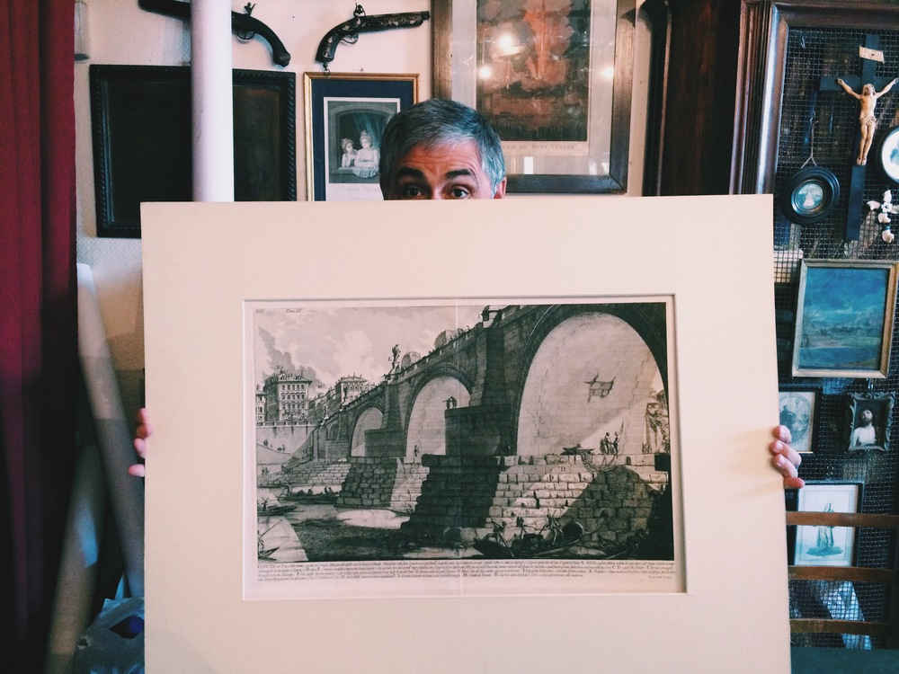 #78. An art dealer named Francesco (who I did not make out with), holding my first real art purchase. It's a first edition Piranesi and it's of the bridge across from Castel Sant'Angelo in Rome. You can actually see the building we are standing in in the etching.