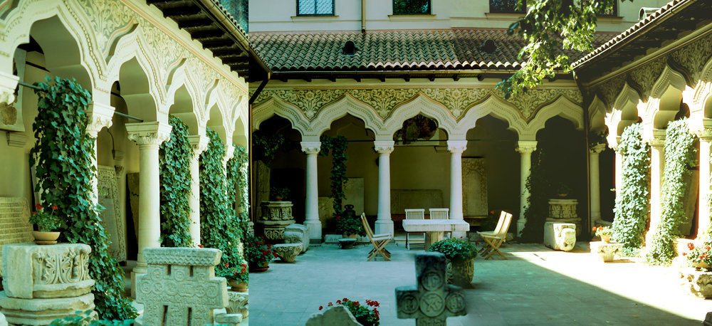 The courtyard of Stavropoleos Church. Built in Brâncovenesc style, also known as Wallachian Renaissance and Romanian Renaissance, is an art and architectural style that evolved during the administration of Prince Constantin Brâncoveanu in the late 17th and early 18th centuries