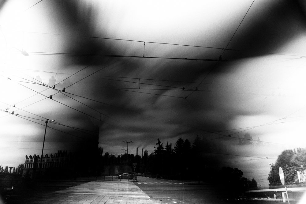 Nowa Huta, former Soviet era Steel Works and Town. Triple exposure, facing opposite ways. Different timings, ND and wide for the clouds, hence the unusual 'x' pattern and regular exposure for the car/ crossing section. And 1 bonus exposure for the tram station bottom right.