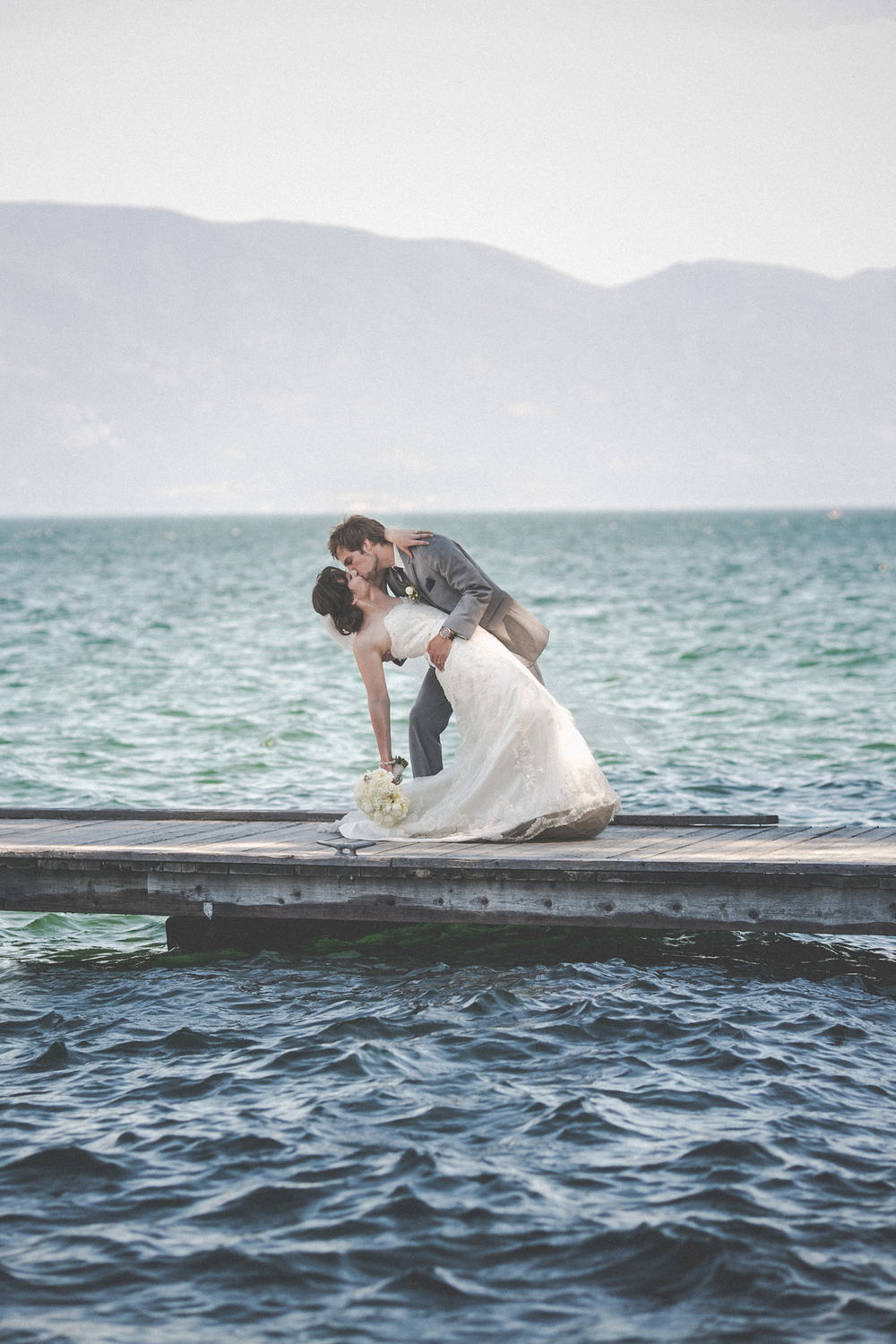 Spruce-Lodge-Flathead-Lake-wedding-dock-kiss.jpg