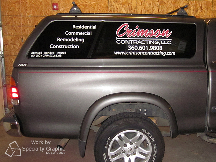 Truck canopy lettering for Crimson Contracting.