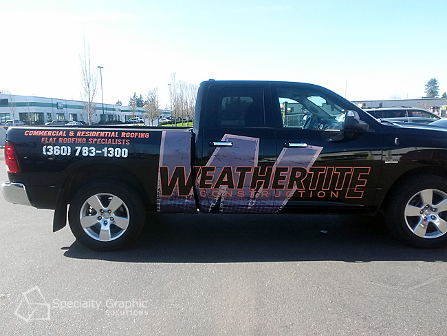 Partial truck wrap for Weathertite Construction.