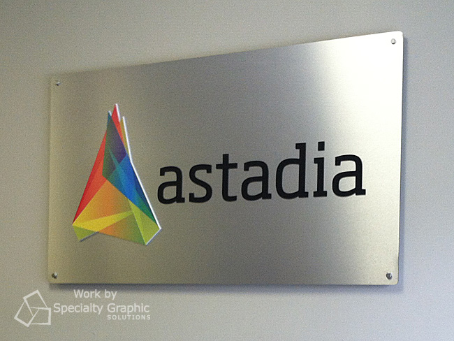 Company logo reception sign on brushed metal for Astadia.
