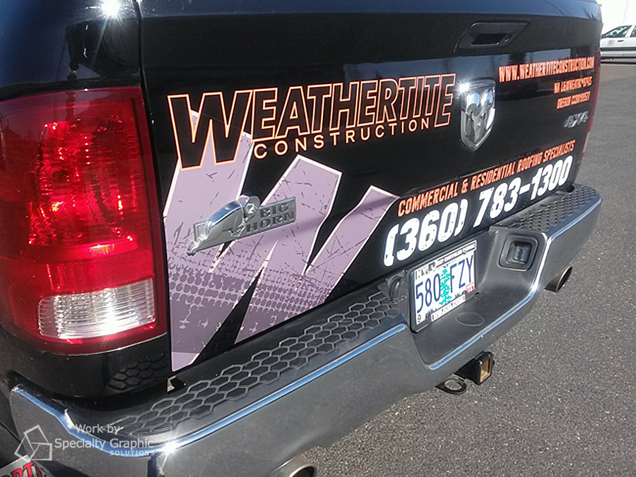 Logo on back of Weathertite Construction truck.