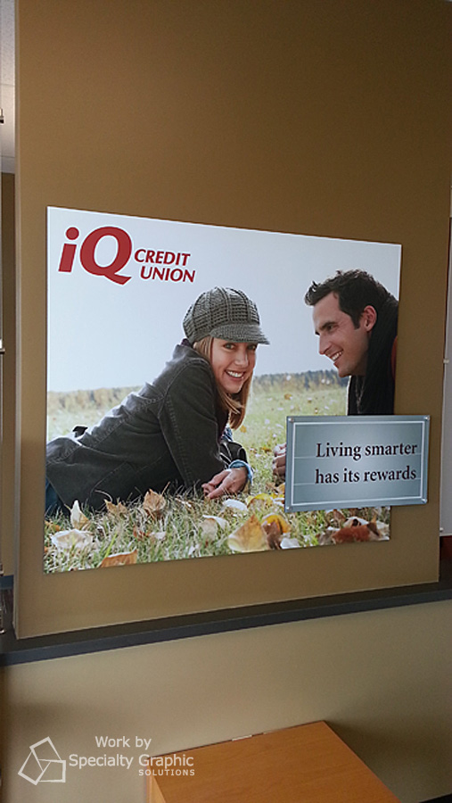 Lobby sign for iQ Credit Union.