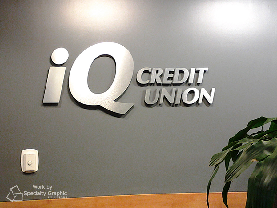 Raised lettering sign for iQ Credit Union.