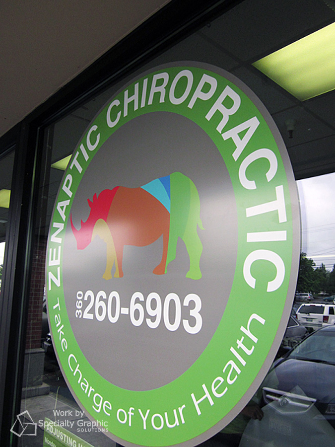 Window logo on window for Zenaptic Chiropractic.
