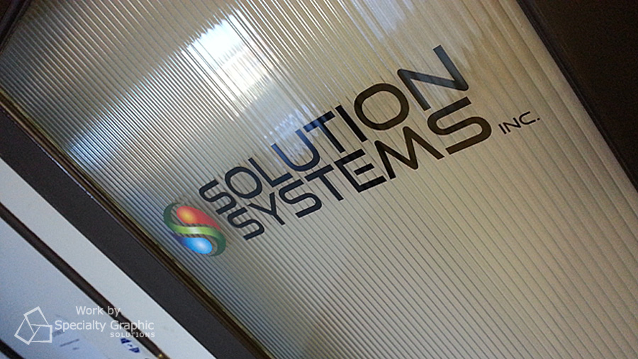 Company logo on glass door. Solution Systems.