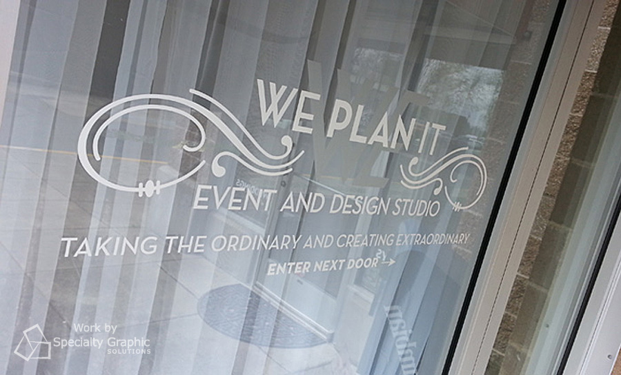 We Plan It logo and lettering on glass.