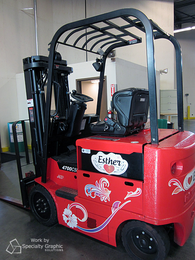 Graphics and lettering on forklift.