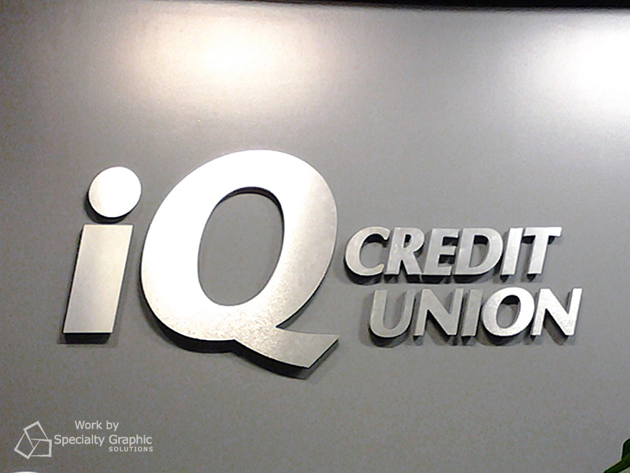 Brushed metal dimensional lettering for iQ Credit Union.