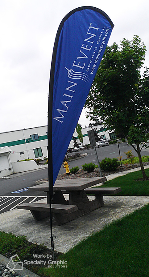 outdoor flag for restaurant main event.jpg