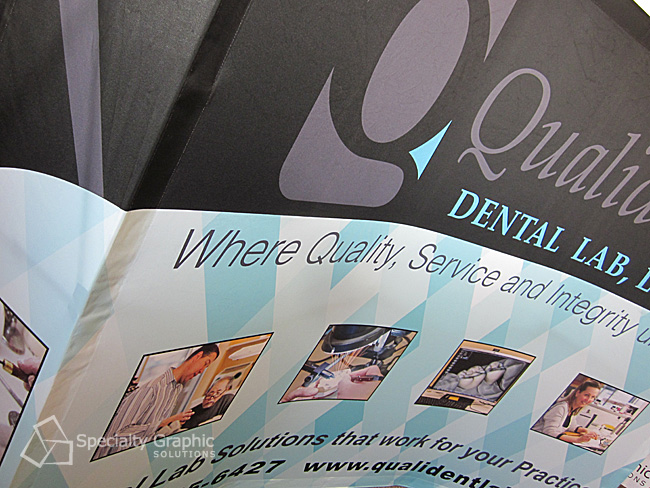 curved trade show banner close up qualident.jpg