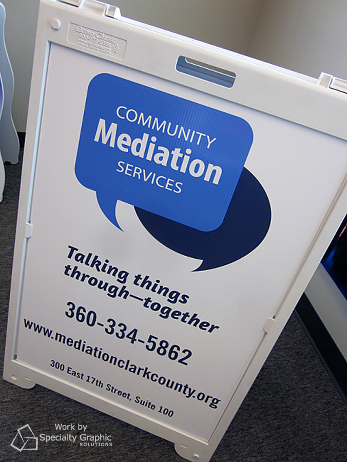 sidewalk sandwich board sign community mediation.jpg