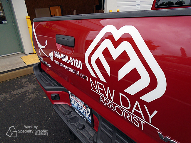 cut vinyl lettering new day arborist.jpg