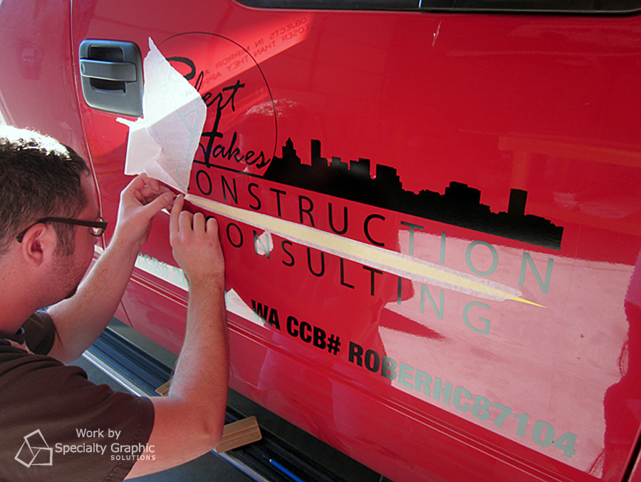 cut vinyl logo on truck door robert hakes construction.jpg