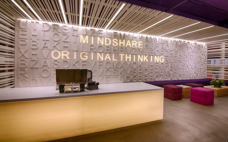 This reception sign by The Bold Collective brands the space and serves as a great piece of art too.