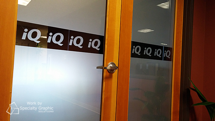 frosted conference door with logo iq credit union.jpg