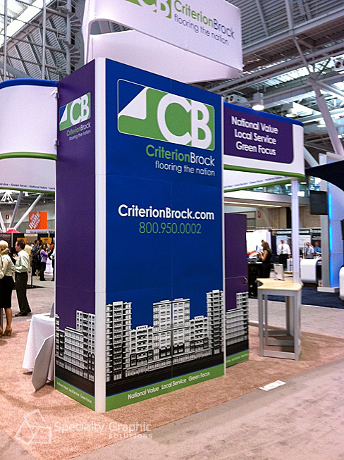 Criterion Brock's trade show display actually has a cabinet as part of the design so staff can store materials and anything else they need for attendees.