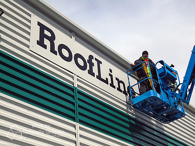 Installing Roofline Supply building signs in Vancouver WA.jpg