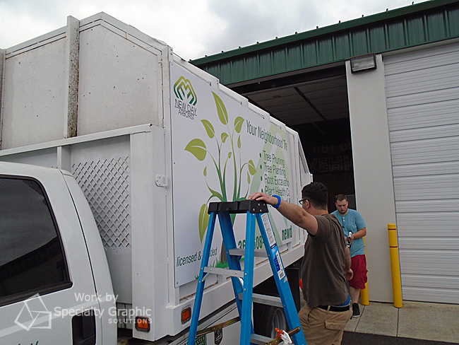 Installing advertising panels on truck in Vancouver WA.jpg