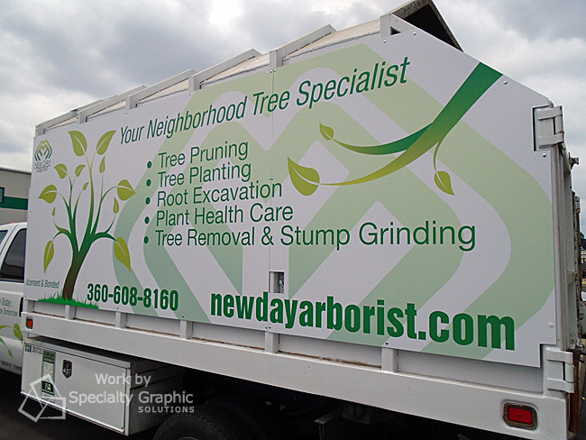 Vehicle Graphics look great on New Day Arborist truck.jpg
