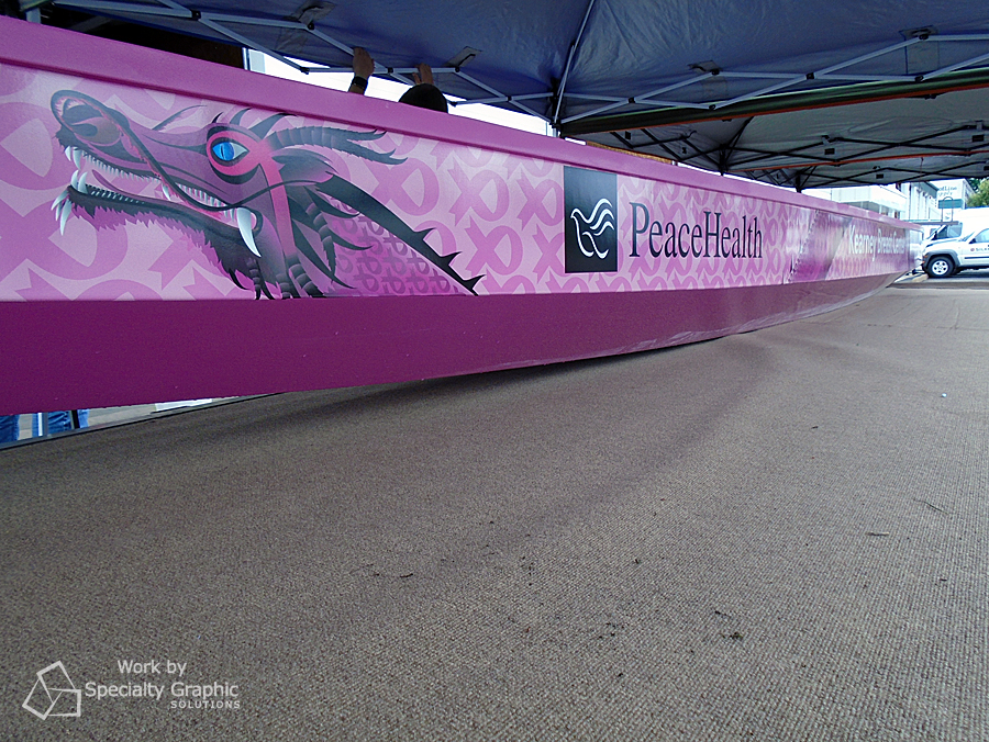 Pink dragon boat wrap celebrates breast cancer survivors courtesy of Peace Health.jpg