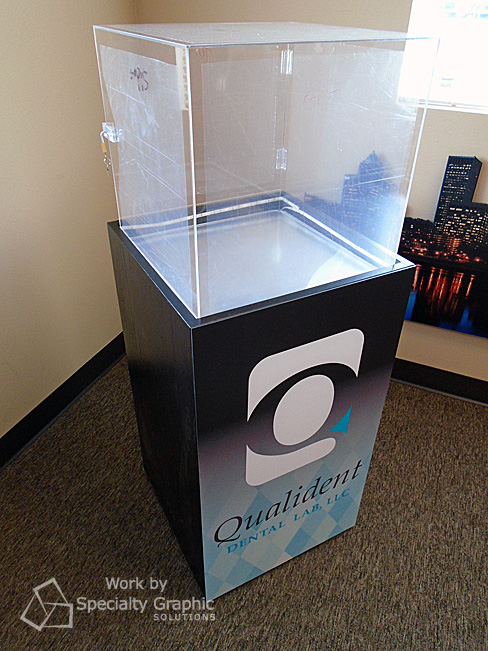 Graphics on custom trade show display cabinet for Qualident Dental Lab.jpg