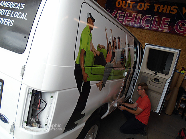 Installing a partial van wrap for You Move Me of Vancouver WA.jpg