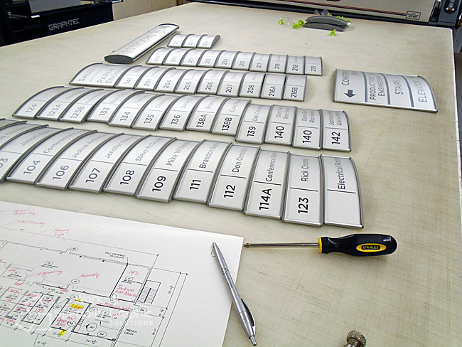 Preparing changeable name plates for new Smith-Root HQ Offices in Vancouver WA.jpg